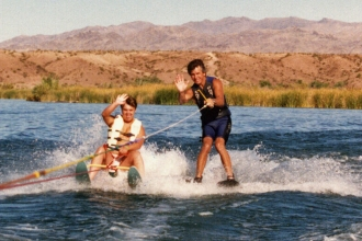 1986: Mike on the water during an Arizona Special Olympics Event. Mike was a longtime volunteer of his time and money for special needs riders.