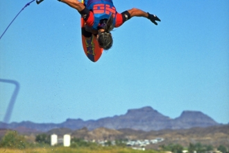 1993: Mike goes over the top on a front flip. Parker Strip of the Colorado River. Photo Rick Doyle.