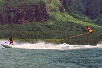 1996: Playing in the Tahiti surf beind a PWC. Mike has always enjoyed jumping waves, from the 1970s on his slalom ski, for decades on his hydrofoils, and currently on his customized sit down PWCs.