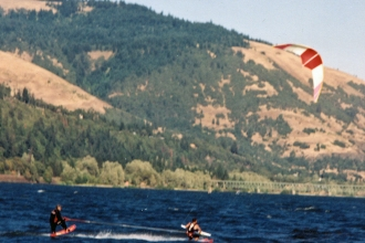 1996: Mike gets a lift from one of the kite skiing inventors Corey Roesler. (Now known as kiteboarding).